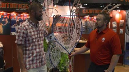 Mike Powell with Cumings highlights the features of the Red, White & Blue net with Game & Fish's Adam Heggenstaller at ICAST 2021 in Orlando.