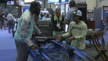 A bow-to-stern look at NuCanoe's Unlimited with NuCanoe's Ray Martinez and OSG's John Deshauteurs at ICAST 2021 in Orlando.