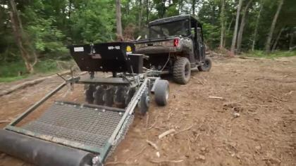 In Part 2 of this 3-part video series, NAW staff members Haynes Shelton and Sam Forbes explain how to properly plant your desired food plot seed with compact equipment. To showcase just how effective small equipment can be for whitetail food plotters, Haynes and Sam get all their work done with a Polaris Ranger UTV and Micro Food Plot's all-in-one Master Series pull behind unit. After a few hours in the North Carolina heat the two have the dirt turned up, the seed spread, dragged and cultipacked for proper seed-to-soil contact.