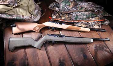 Thompson/Center Arms rimfire rifles are available with Traditional Hardwood and Flat Dark Earth Black Grit finishes.
