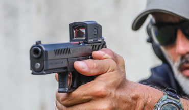Reflex sights may be all the rage with law enforcement agencies right now, but the Aimpoint Acro P-1 stands out among red dots for its rugged construction and intelligent features; here's why.