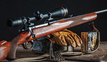 The Husqvarna AB. Mauser Series 1100 Deluxe features a European walnut stock, a non-military action, and a two-position  wing-type safety.