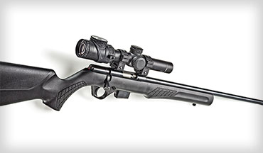 The Rossi RB22M .22 WMR bolt-action rifle features a synthetic stock, a crossbolt safety, and a detachable five-round magazine. The rifle comes with scope mount bases installed.