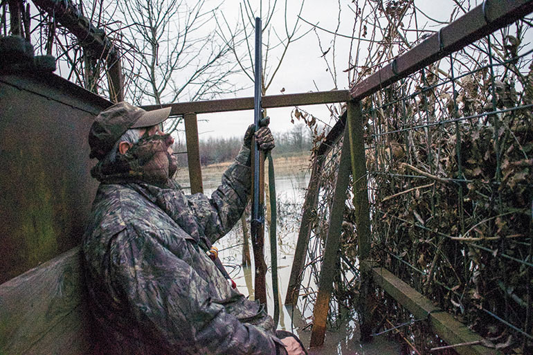 duck hunter sitting in blind