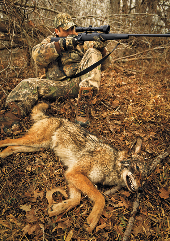 hunter with coyote