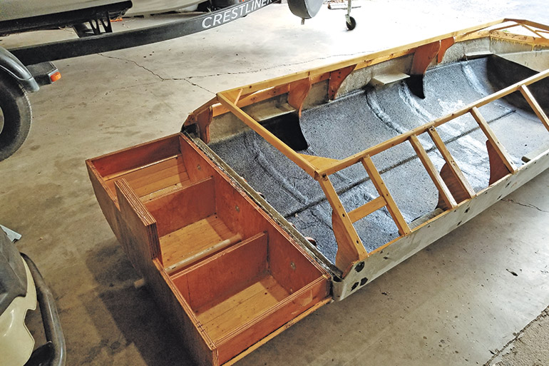row boat being converted into duck blind
