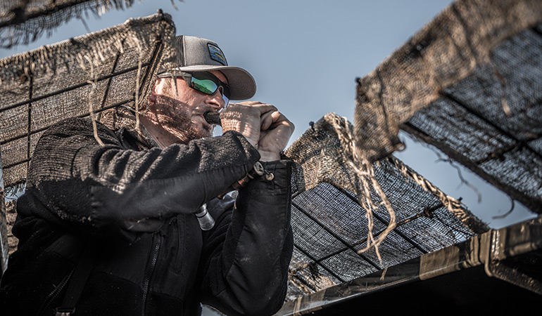 waterfowl guide calling from blind