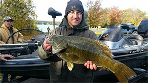 Fishing on Michigan's Hubbard Lake on Sunday, Oct. 18, 2015, during a bass tournament, Greg Casiciel reportedly landed a 9.33-pound smallmouth, a potential new state record.