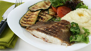 Flounder has a delicate texture and will fall apart easily if it is not handled with care when cooking.