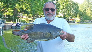 Barely a year after the previous record was set, a Florida man travels north to land a nearly 10-pound state record smallmouth bass while fishing in Cheboygan County, Michigan.