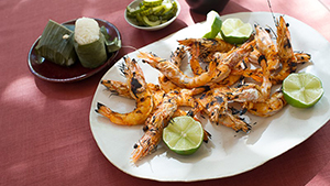 Bring the exotic and colorful flavors of Thailand to the table with this grilled prawn and pickled cucumber recipe.