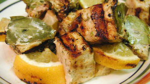 Swordfish steak is thick, juicy and even better when cooked Sicilian style.