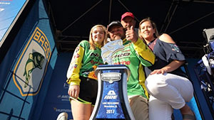 After starting Championship Sunday more than 8 pounds ahead of his nearest competitor, Tim Horton struggled but held on tight to win his first championship in a decade at the Bassmaster Elite at Lake Okeechobee.