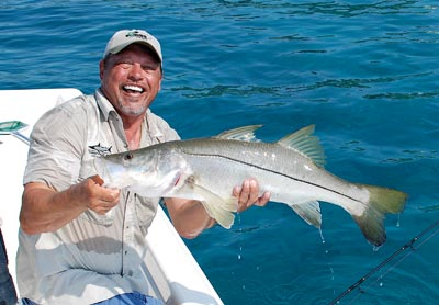 Henry Waszczuk with a snook, one of many species of fish available for anglers in Key West.